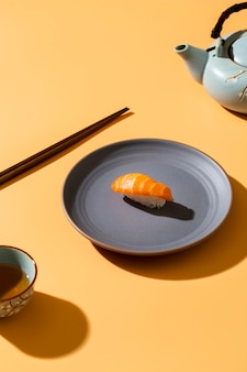 Salmon nigiri on plate with decor