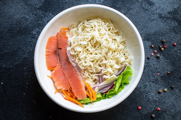 Salmon rice noodles or wheat glass pasta seafood diet pescetarian