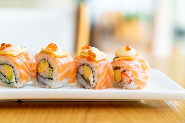 Salmon roll sushi with cheese on top - japanese food style