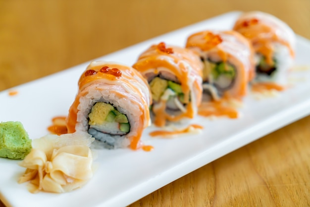 Salmon roll sushi with sauce on top - japanese food style