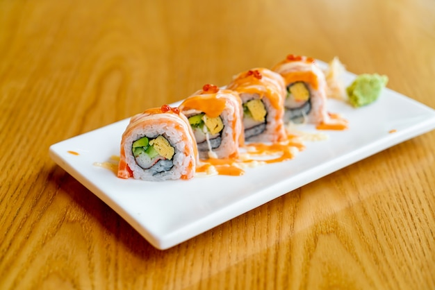 Salmon roll sushi with sauce on top. japanese food style