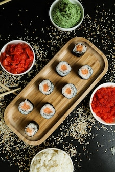 Salmon roll with rice, sesame, ginger and wasabi