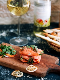 Salmon rolls with glass of white wine