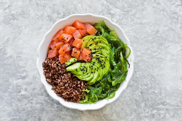 Salmon salad, avocado, brown rice, seaweed.