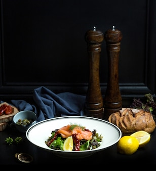 Salmon salad with fresh vegetables