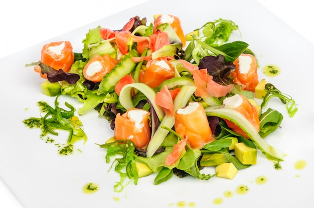 Salmon salad with greens and vegetables