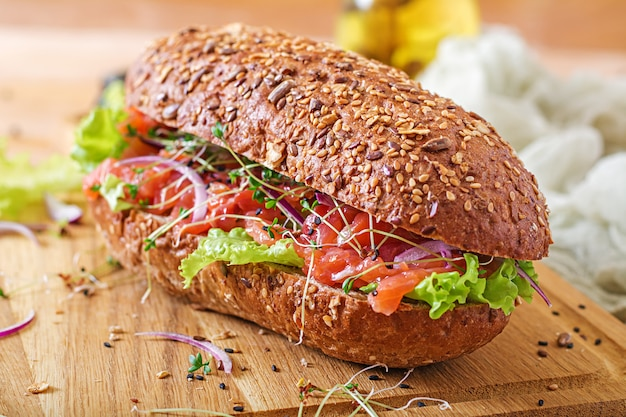 Salmon sandwich - smorrebrod with cheese cream and microgreen