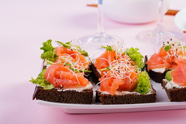 Salmon sandwiches with cream cheese and microgreen
