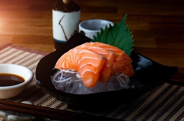 Salmon sashimi cutting and surve.