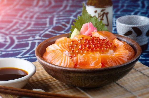 Salmon sashimi and salmon roe with rice.