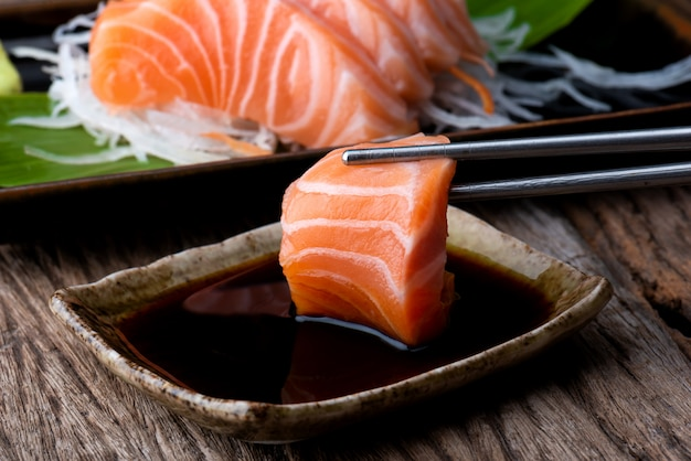 Salmon sashimi with shoyu sauce.