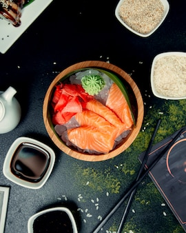 Salmon slices in wooden plate
