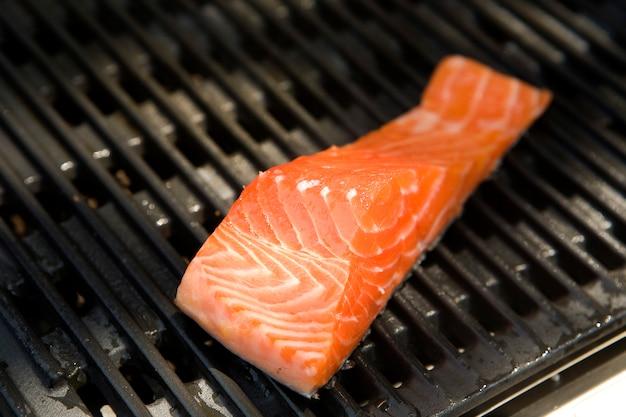 Salmon steak cooking on roaster