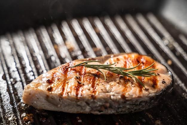 Salmon steak in the frypan.