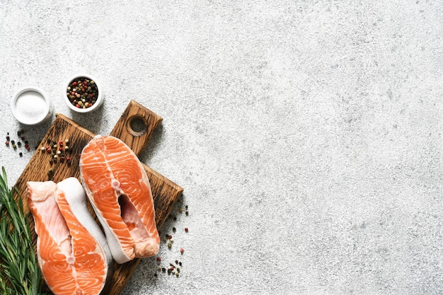 Salmon steak raw fish with spices prepared for cooking.