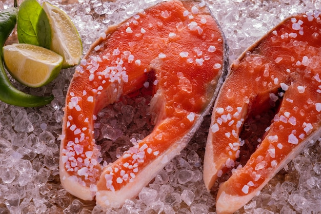 Salmon steak raw in ice.
