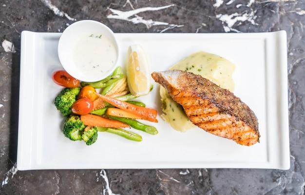 Salmon steak with mash potato and vegetable