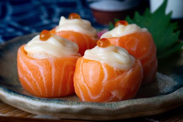 Salmon sushi ball roll.