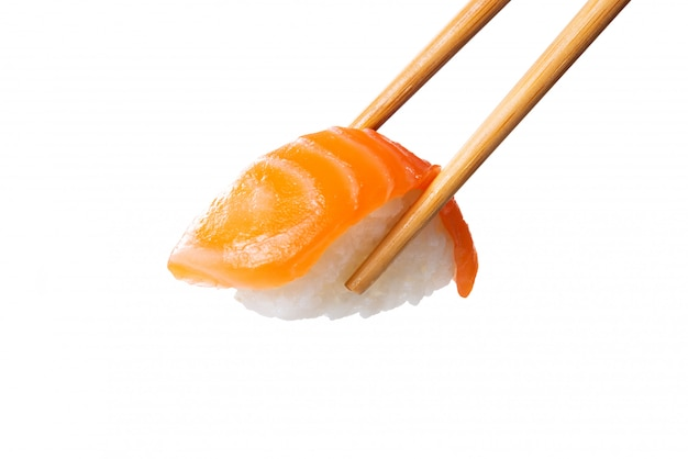 Salmon sushi nigiri in chopsticks