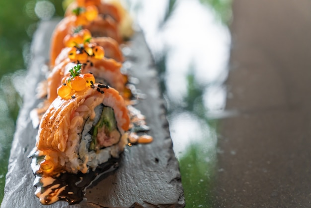 Salmon sushi rolls with foie gras