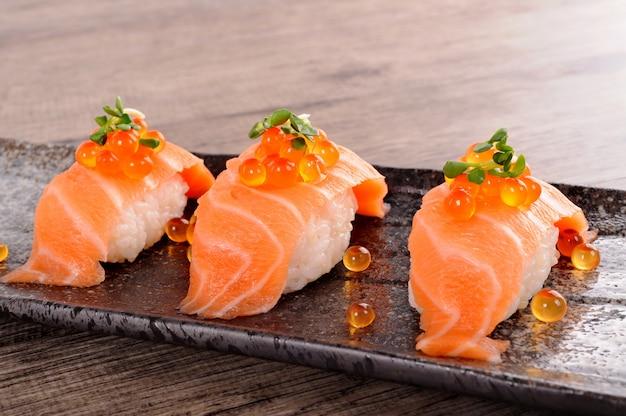 Salmon sushi with caviar