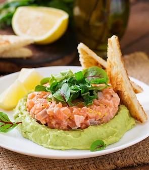 Salmon tartare with avocado mousse.