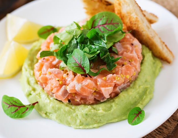 Salmon tartare with avocado mousse.
