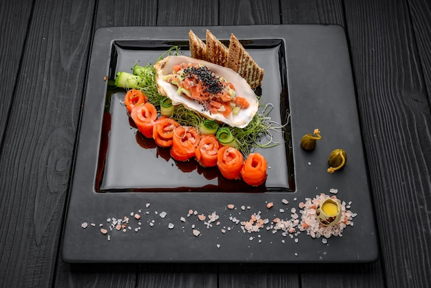 Salmon tartare with fresh vegetables and toast. on the wooden table