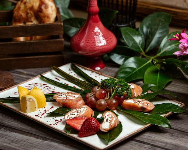 Salmon with fruits in the plate