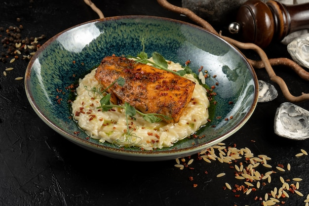 Salmon with orzo pasta. a hot main course of sea fish and pasta