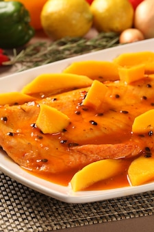 Salmon with passion fruit in the plate.