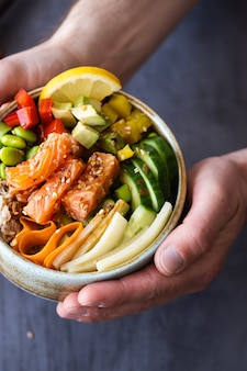 Salmon with vegetables on rice photography