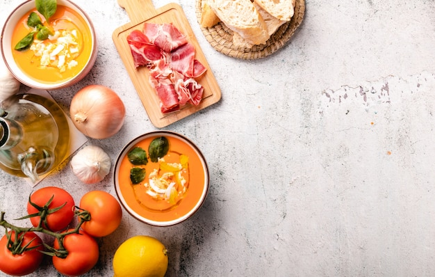 Salmorejo soup with ham and eggs in a bowl.  and