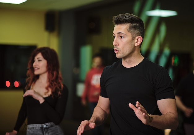 Salsa and bachata teachers in a class