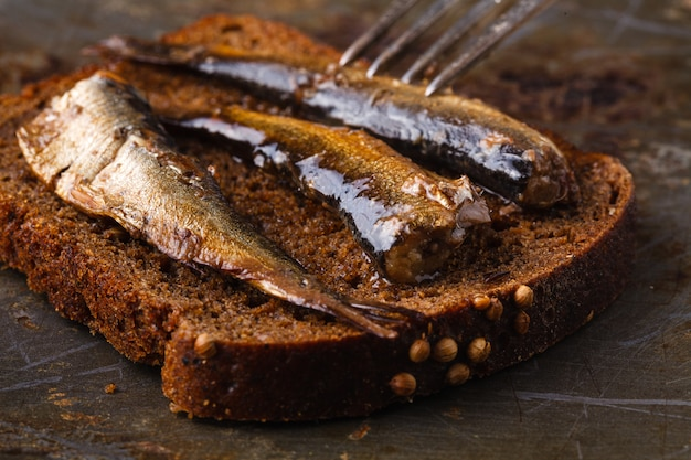 Under salt anchovies with slice of bread