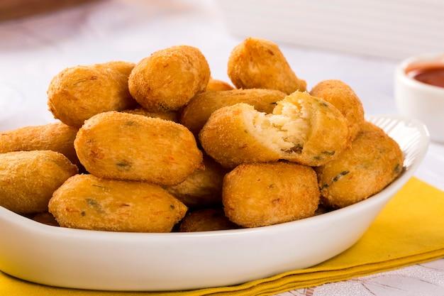 Оладьи из соленой трески, bunuelos de bacalao