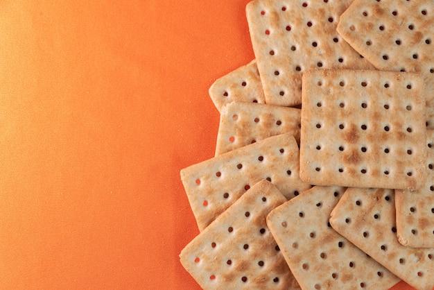 Salt crackers on the orange background