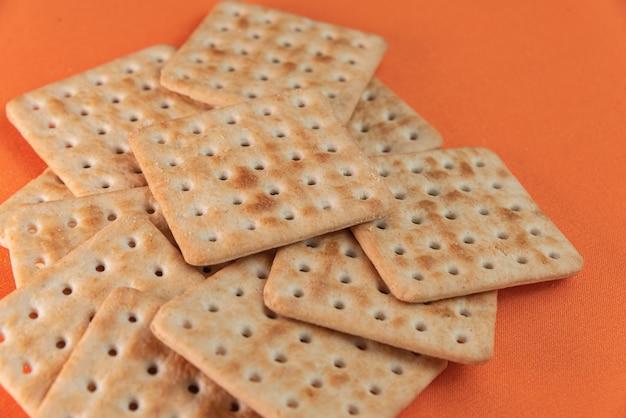 Salt crackers on the orange table
