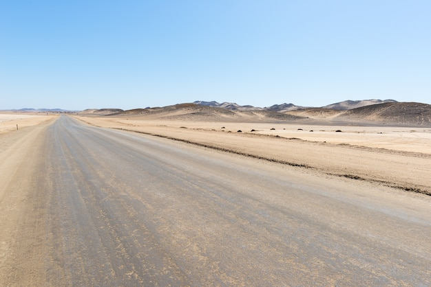 Salt road crossing the namib desert, best travel destination in namibia, africa.