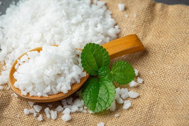Salt in wooden spoon place on floor