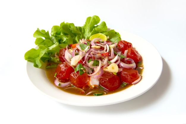 Salted egg yolk spicy salad chili paste. thai food on dish isolated on white background