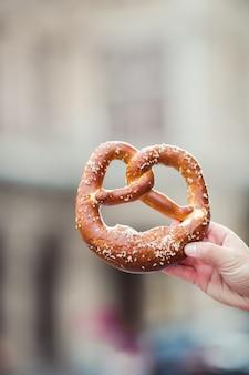Salted pretzel in the hands