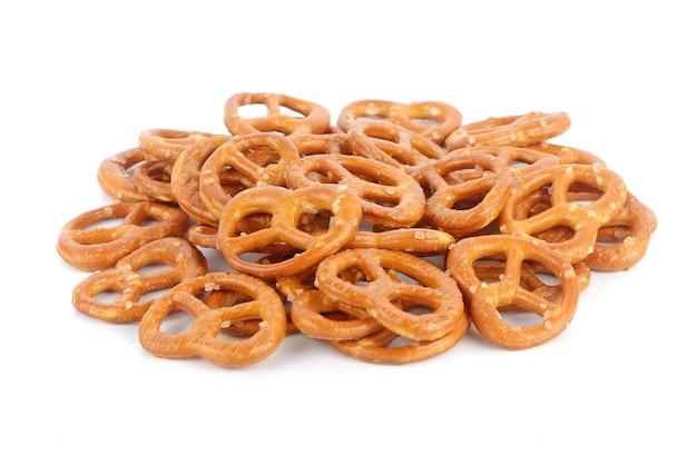 Salted pretzels on white background