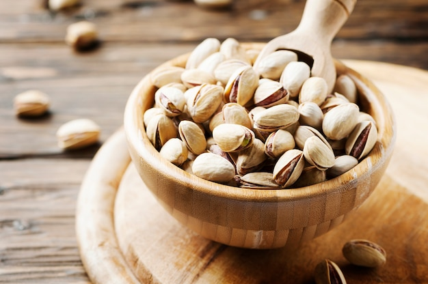 Salth pistachios on the wooden table