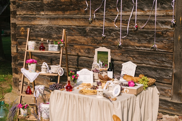 Salty bar. celebration. cheese bar. cheese bar of several kinds of cheese, grapes, olives and bread decorated on vintage wooden table with curved metal legs