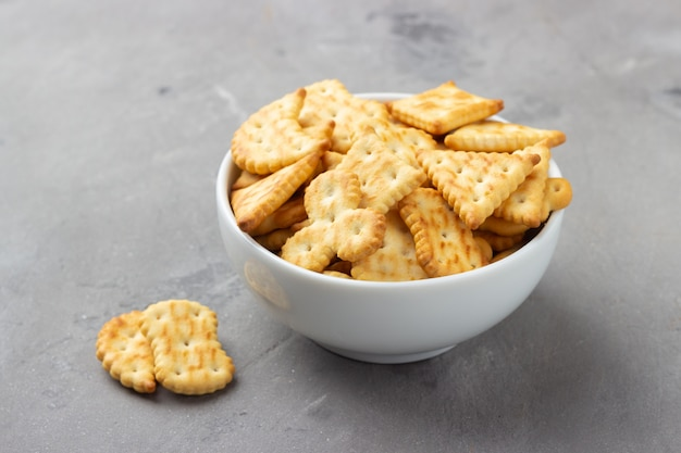 Salty crackers in bowl closeup