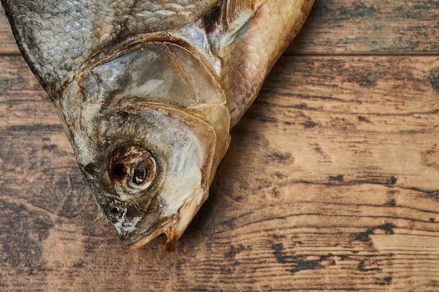 Salty stockfish on wooden table. common bream (abramis brama)