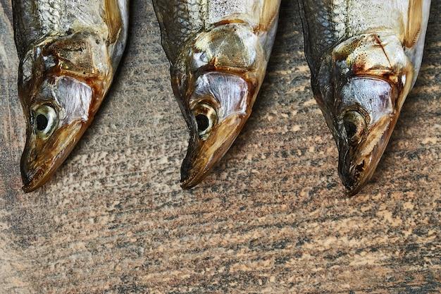 Salty stockfish on wooden table. rainbow smelt (osmerus mordax)