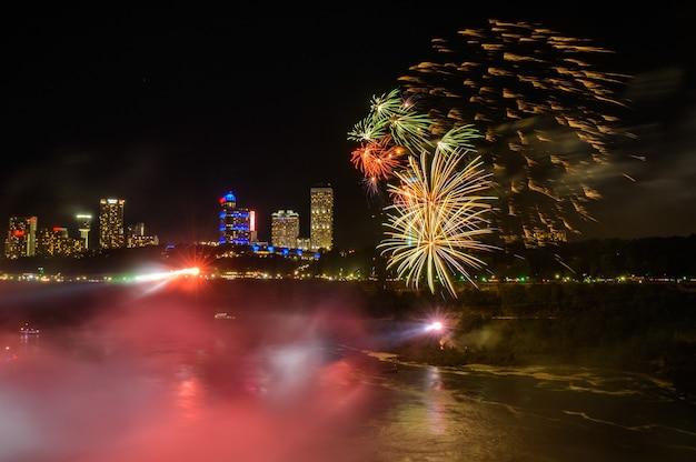 Salute, beautiful fireworks. waterfall at sunset