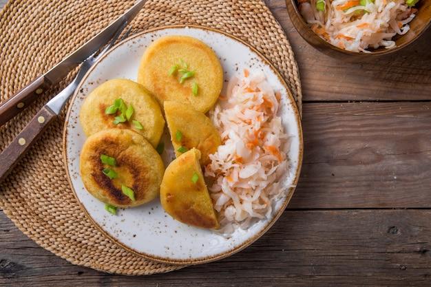 Salvadoran pupusa served with curtido